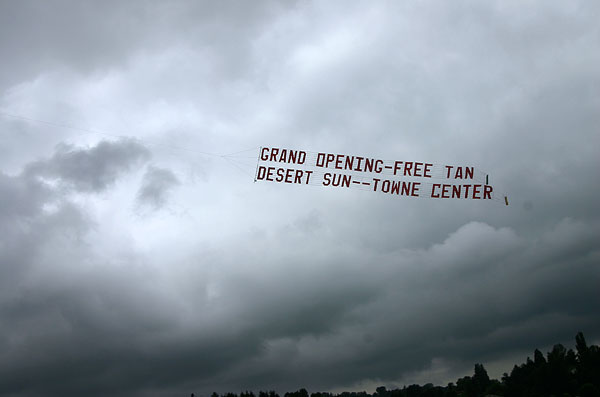 Grand Opening - free tan Desert Sun - - Towne Center